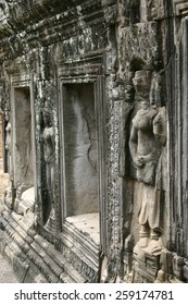 Stone carved bas relief line a temple wall at the jungle complex of Angkor Wat in Cambodia