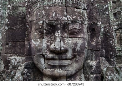 Stone carved Buddha face on ancient khmer Bayon temple in Angkor Wat complex near Siem Reap, Cambodia