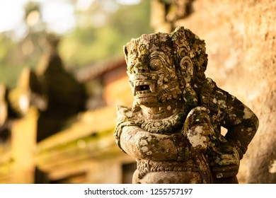 Stone carved demons protecting the staircase entrance of Pura Kehen hindu temple in Bali, Indonesia.
