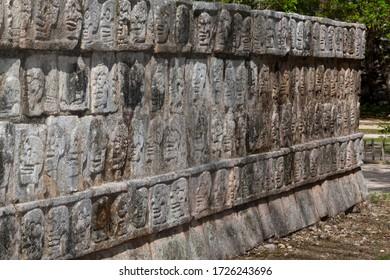 Stone carved skulls on The Tzompantli at Chichen Itza, Yucatan, Mexico. 25th May 2012