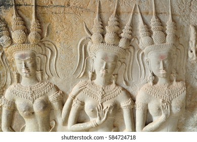 Stone carving of angels or Apsara on the wall of Angkor Wat