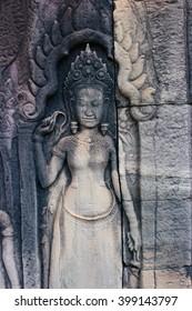 Stone carving Apsara in Angkor Wat temple at cambodia