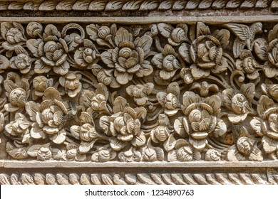 Stone carving with floral pattern at Balinese Hindu temple Pura Puseh Desa Batuan, Batuan village, Kabupaten Gianyar, Bali, Indonesia