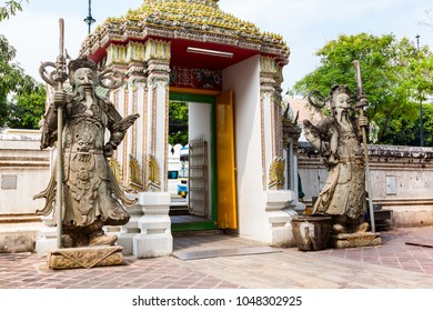 Stone carving giants infront of the gate of Wat Pho in Bangkok Thailand