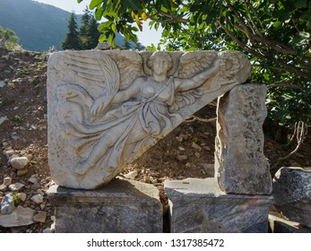 Stone carving of the goddess Nike at the ruins of the ancient city of Ephesus, Selcuk town, Izmir Province, Turkey