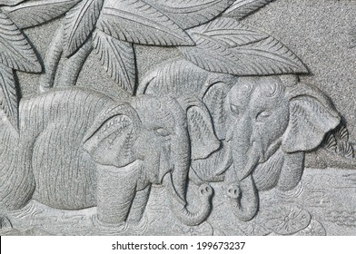 stone carving of two loving elephants