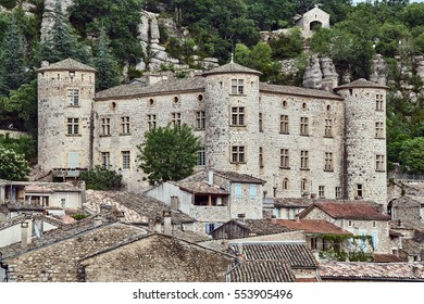 Stone castle and homes in the medieval town of Vogue in France