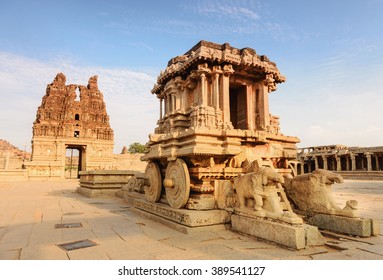 Stone chariot in courtyard of Vittala Temple at sunset in Hampi, Karnataka, India