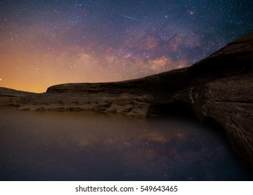 Stone cliff river With starry milky way galaxy and sky night light beautiful