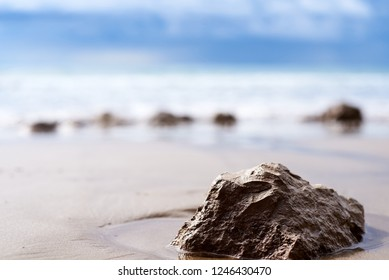stone closeup, on the background of the sea, sea, waves, dark sky