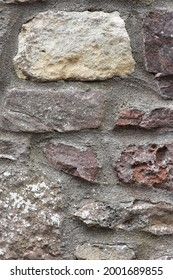A stone coloured brick wall