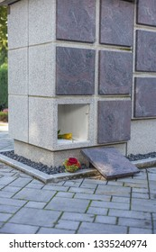 A stone columbarium with an empty niche and without an urn