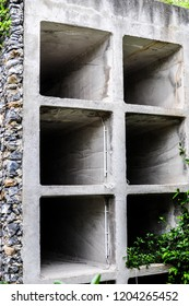 A stone columbarium with empty niches and power