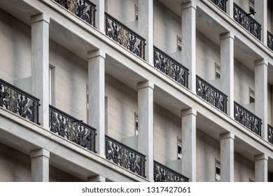 Stone column Greek hotel balcony - ancient classic architecture detail