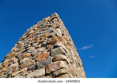 Stone column on a background of the blue sky