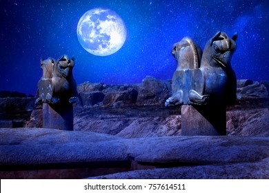 Stone column sculpture of a Griffin in Persepolis against a moon and stars.  The Victory symbol of the ancient Achaemenid Kingdom. Iran. Persia. Shiraz. Artistic night  fantasy image.