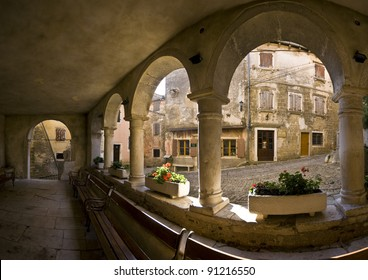 Stone columns and interior of the medieval loggia in Groznjan