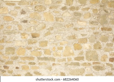 Stone and concrete Tuscan wall background in Italy.