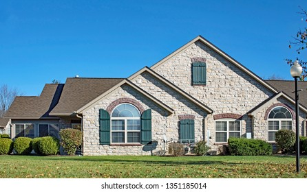 Stone Condo with Teal Shutters