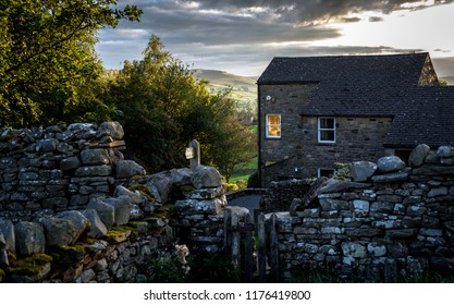 A stone cottage at dusk in the Yorkshire Dales, England, Uk.