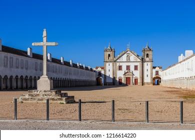 Stone Cross, Church and Pilgrim lodgings of Santuario de Nossa Senhora do Cabo Sanctuary. Cabo Espichel Cape. Baroque architecture. Sesimbra, Portugal