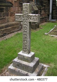 stone cross in a church yard in england