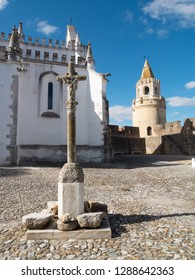 Stone cross in front of the convent of Viana do Alentejo, Evora, Portugal.
