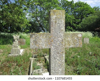Stone cross memorial in churchyard
