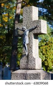 Stone cross with metal figurine of jesus christ