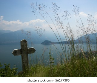 A stone cross on a hilltop in Griante, Lake Como, Italy.
