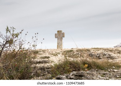 Stone Cross and six-pointed Lotus. It is near Christian Orthodox church in Old Orhei Moldova.