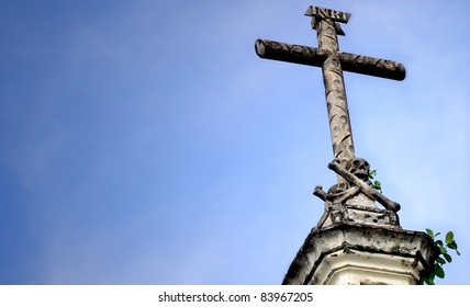 a stone cross with sky for copy space