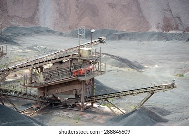 stone crusher machine in an open pit mine