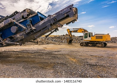 Stone crusher machine in a quarry or open-pit mine, to transform into gravel