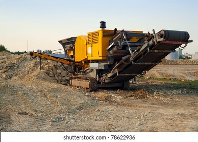 Stone crusher parked by the construction site