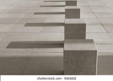 Stone cubes on the sidewalk
