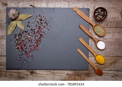 Stone cutting board and spices on an old kitchen table