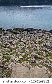 Stone entrance to a rocky beach, coast near Mali Losinj, island Losinj, Croatia, Adriatic coast, Europe