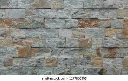 Stone facade tiles. Background texture.