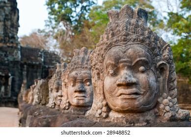 stone faces at Angkor Thom South Gate entrance, Cambodia