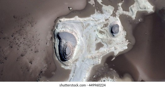 stone fantasy fantastic animal emerging from the ashes, polluted desert sand, tribute to Pollock, abstract photography of the deserts of Africa from the air, bird's eye view, abstract expressionism,