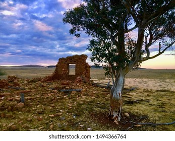 Stone Farmhouse Ruins Australian Outback Tree Sunset Clouds
