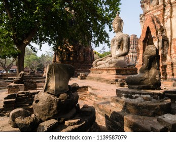 A stone figure of Buddha in the ruins of Ayutthaya royal buddhist temple, Thailand.