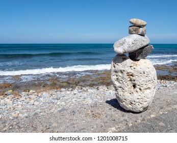 Stone figure staring at the sea, the island of Crete, Greece