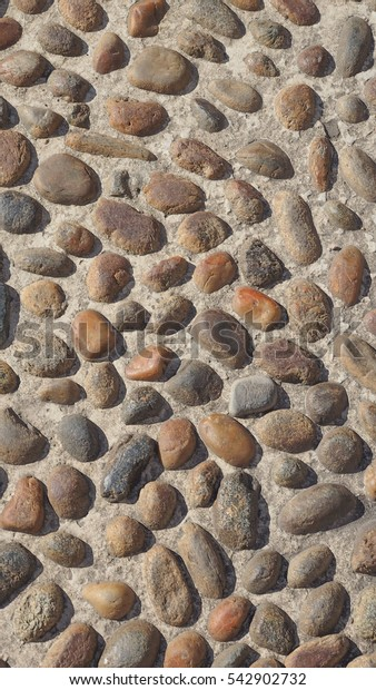 Stone floor texture useful as a background - vertical