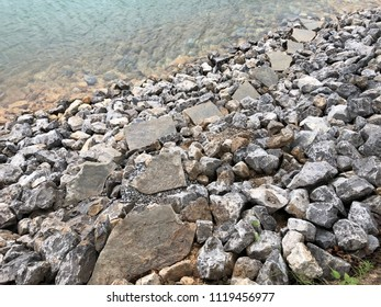 Stone foot path to the lake built on rocks