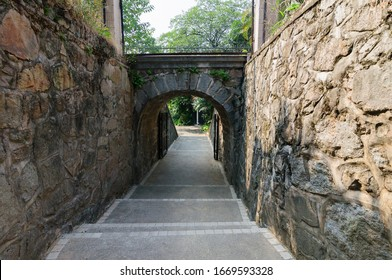 Stone footpath between stone walls and through a door