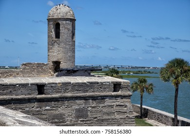 stone fort with cannons on ocean bay