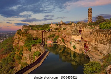 a stone fortress on the hill of fort chittorgarh in india in evening at sunset. architectural landmark
