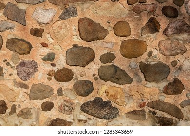 Stone foundation wall on a restored barn in a Wisconsin park